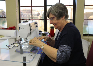 Marg Hall sews Friday afternoon during Quilting By The Bridge. Jillian Danielson/RiverScene