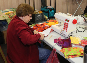 Dee Ward works on a pattern during Quilting By The Bridge Friday afternoon. Jillian Danielson/RiverScene