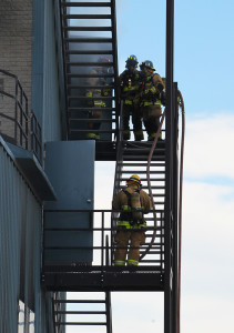 Firefighters train Friday morning during a Live Burn. Jillian Danielson/RiverScene