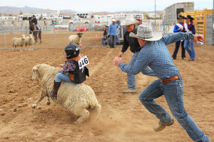 A cowboy chases after Ryliegh Mytinger during the Mutton Bustin Saturday morning. Jillian Danielson/RiverScene