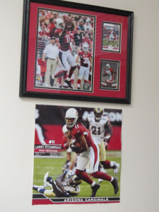 Sasseen's Larry Fitzgerald photos hang on her office wall. Judy Lacey/RiverScene