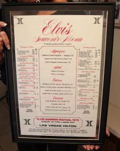 Evie framed a menu from the Elvis concert at the Hilton. Jillian Danielson/RiverScene