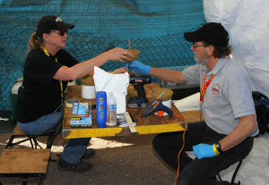 Gina and Victor Papini build firework shells Thursday morning to prepare for Winterblast. Jillian Danielson/RiverScene