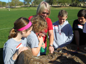 Linda Leuck works with students on a water conservation lesson Wednesday morning at Rotary Park. Jillian Danielson/RiverScene