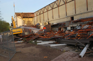 Crew work to tear down the front of a portion of the English Village early Tuesday morning. Jillian Danielson/RiverScene