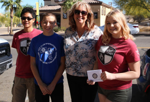 Francis Mendoza, Jonathan Gomez, Laura Denny, and Rihanna Scoggins receive a check in the amount of $2500 for the Future Business Leaders of America. Jillian Danielson/RiverScene
