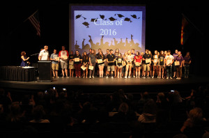 Students line up on the stage and receive the Principal's Honor Roll award. Jillian Danielson/RiverScene
