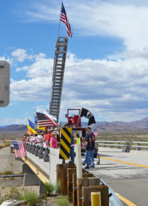 Supporters line an overpass Wednesday afternoon on the I-40 to show their appreciation for the Run For The Wall. Judy Lacey/RiverScene