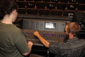 Autumn Riggins and Brandon Plunkett prepare the soundboard Monday afternoon. Jillian Danielson/RiverScene