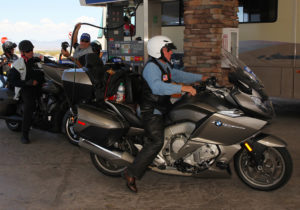 Riders pull up to the Cheveron Station to gas up for the next leg of the trip. Jillian Danielson/RiverScene