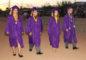 Students walk the high school track during graduation Thursday evening. Jillian Danielson/RiverScene