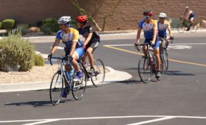 Cyclists ride into the Walmart parking lot for refreshments Friday morning. Jillian Danielson/RiverScene