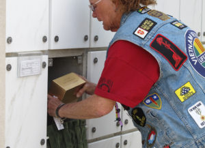 Pat Marcikese places John's ashes at Arlington in 2011.Judy Lacey/RiverScene