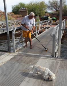 Volunteer, Roger Burt, cleans one of the docks Thursday morning in the Bill Williams Refuge. Jillian Danielson/RiverScene