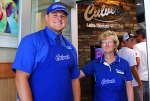 Owner Lukas Stewart and Dianne Mayer pose for a photo at the Culvers entrance. Jillian Danielson/RiverScene