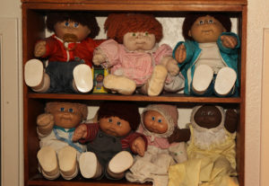 A collection of Angela's Cabbage Patch Dolls are displayed on a shelf in her home. Jillian Danielson/RiverScene