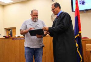 Graduate Larry Woodrum receives certificate from Judge Kalauli. Rick Powell/RiverScene