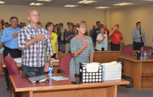 Court personnel and visitors recite the Pledge of Allegiance. Photo courtesy Ron Silva