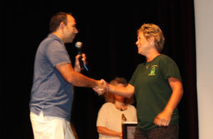 Chad Nelson presents $500 to Bonnie Helman from the raffle. Jillian Danielson/RiverScene
