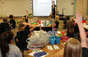 Denelle Esmay welcomes her second grade class on the first day of school. Jillian Danielson/RiverScene