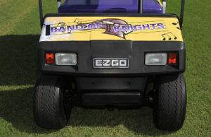 """The front of the golf cart wrapped with """"Band of Knights."""" Jillian Danielson/RiverScene"""