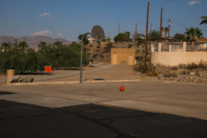 A basketball hoop is located on the edge of the parking lot. Rick Powell/RiverScene