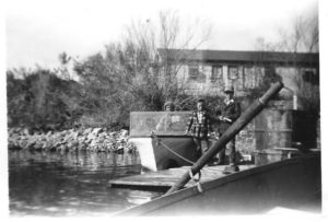 Butch Wood - in plaid jacket - and his grandfather Doc Young at his dock at Site Six 1953 or 54.