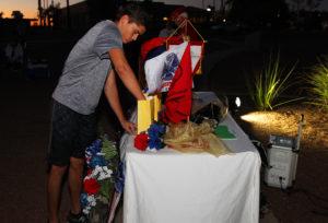 The nephew of Aaron Merritt lights a candle for his uncle. Jillian Danielson/RiverScene