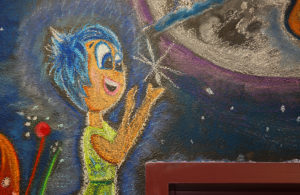 """""""Joy"""" from the movie """"Inside Out"""" is Amelia's favorite character on the mural. Jillian Danielson/RiverScene"""