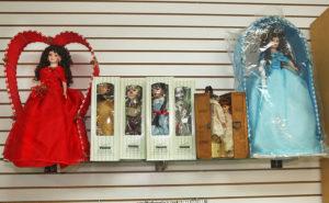 Dolls sit on display at Best Pawn. Jillian Danielson/RiverScene