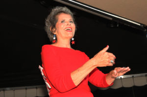 """Sue performs """"God Bless The USA"""" in sign language during the pageant. Jillian Danielson/RiverScene"""