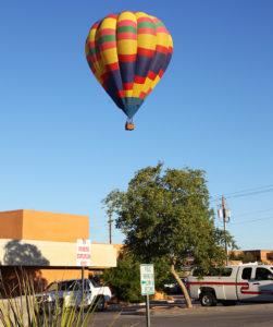Jim Dolan flies over a fire station Thursday morning. Jillian Danielson/RiverScene