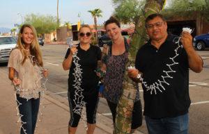 Debi Pennington, Kathy Dolan, Jamie Streeter and Jose Madera pose with lights Thursday morning. Jillian Danielson/RiverScene