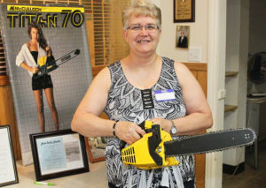 Mary Erlandson poses with a chainsaw that she helped build when she worked for Robert McCulloch Sr. Jillian Danielson/RiverScene