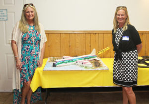 Sheila McCulloch Press and Jean McCulloch pose for a photo next to the cake that was made for the reunion. Jillian Danielson/RiverScene
