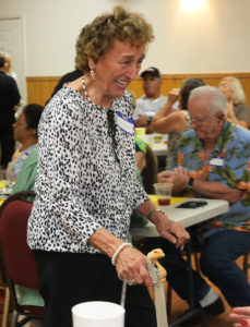 Wanda Adams walks back to her seat with a cane that was given to her for being the oldest woman in attendance. Jillian Danielson/RiverScene
