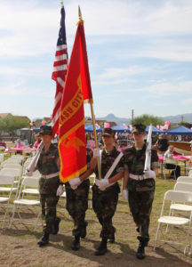 The Young Marines Color Guard carry the colors during Denise's Day. Jillian Danielson/RiverScene
