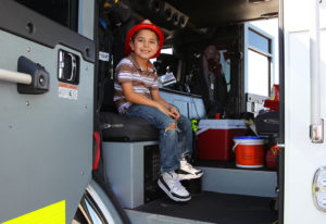Daniel Haro sits in a fire truck Saturday afternoon during the open house. Jillian Danielson/RiverScene
