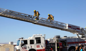 Fire fighters demonstrate a ladder operation Saturday afternoon. Jillian Danielson/RiverScene
