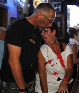 Bob and Tina Geering participate in the Zombie Pub Crawl Saturday evening. Jillian Danielson/RiverScene