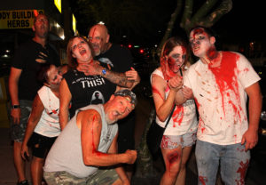 Zombies pose for a photo Saturday evening in front of the Flying X. Jillian Danielson/RiverScene