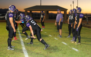 Jeff Baily coaches players at the LHHS Varsity football game Friday evening. Jillian Danielson/RiverScene