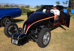 John Laintenen sits in his Roadster Saturday. Jillian Danielson/RiverScene