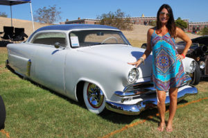 Shannon Anderson poses with her car Saturday afternoon. Jillian Danielson/RiverScene