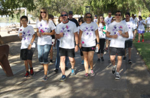 Participants start the Domestic Violence Awareness Walk at Rotary Park. Jillian Danielson/RiverScene