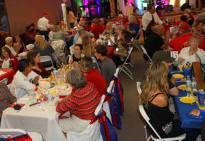Veterans and their families eat at a dinner Wednesday night at Living Word Family Church. Jillian Danielson/RiverScene