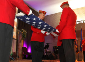Members of the Marine Corps League fold the flag during a dinner at Living Word Family Church. Jillian Danielson/RiverScene