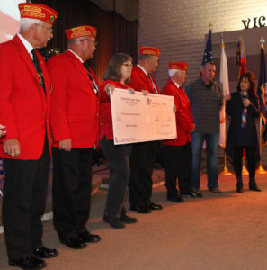 Pastor Maureen Collins and Chris Gall present a $3,000 check to the Marine Corps League to be used for some of their charity work in the community. Jillian Danielson/RiverScene