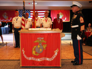 The Marine Corps. birthday cake sits at the front of the room Thursday evening. Jillian Danielson/RiverScene