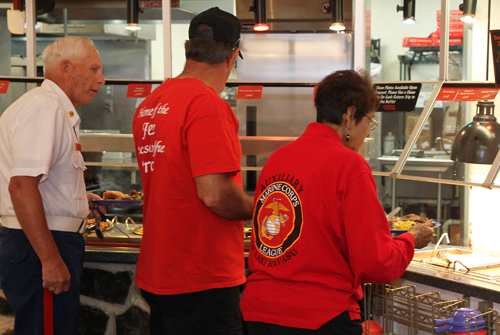 Veterans and a ladies auxiliary member get a dinner at the Golden Corral Monday evening. Jillian Danielson/RiverScene